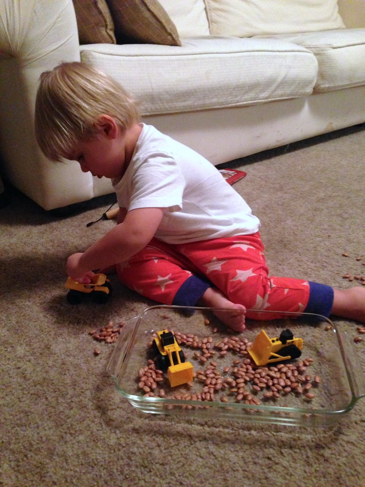 toys-rotation-construction-trucks-and-beans